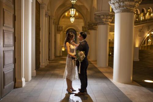 Photographers of Las Vegas - Wedding Photography - Bride and Groom back lit posed photos on the Vegas Strip