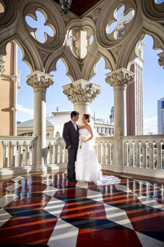Photographers of Las Vegas - Wedding Photography - Venetian architecture wedding photo with bride and groom